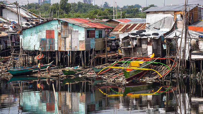 A water-side village in Philippines impacted by disaster.